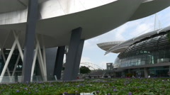 Marina bay sands mall art science museum flowers pond walk singapore Stock Footage