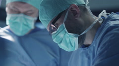 Portrait of Focused and Concentrated Surgeon Performing Surgical Operation - stock footage