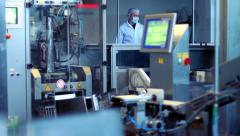 Worker working with cnc machine at industrial workshop. Food packaging line Stock Footage