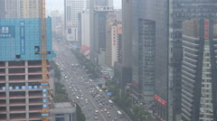 Traffic drives through a main road in central Changsha, China - stock footage