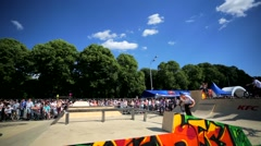 BMX riders perform on a ramp during the BMX Competition. Stock Footage