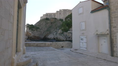 View of canoes and Lovrijenac fortress in  Dubrovnik - stock footage