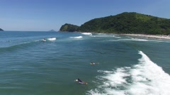 People Surfing and Having Fun in Camburi Beach, Brazil Stock Footage