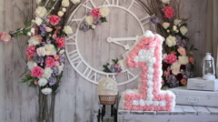 Photo Studio interior decorations, number one on floral background - stock footage