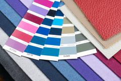 fabric and leather samples with pantone - stock photo
