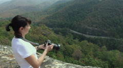 Woman making photo on the top of the mountain_4K_2 Stock Footage
