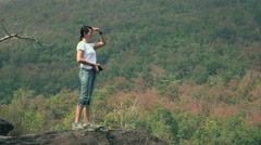 Woman  on the top of the mountain looking around 4K 2 Stock Footage