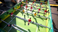 Closeup view, people play table football on a street. Stock Footage