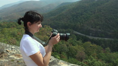 Woman making photo on the top of the mountain_4K_1 Stock Footage