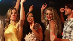 Happy friends dancing in the night club Stock Footage