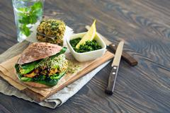 Healthy food: Vegan sourdough burger with sprouted greens and chickpea rissole Stock Photos