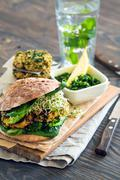 Healthy meal: Vegan sourdough burger with sprouted greens and chickpea rissole - stock photo