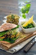 Healthy meal: Vegan sourdough burger with sprouted greens and chickpea rissole Stock Photos