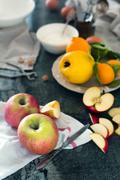 Ingridients for the pie: Apples, lemons, quince and eggs Stock Photos