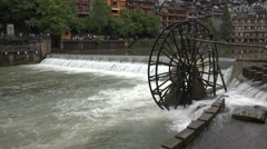 Turning water wheel in the historic town of Fenghuang in China Stock Footage