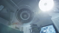 Turning Lights On in Operating Room. Team of Doctors and Nurses over Patient - stock footage