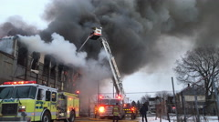 Stock Video Footage of Crew of Dayton Fire Department putting out warehouse fire 4k