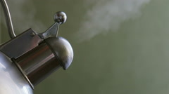 Kettle boiling on a gas stove Stock Footage
