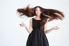 Pretty happy young woman with beautiful long hair in motion Kuvituskuvat