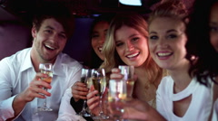 Happy friends holding champagne Stock Footage