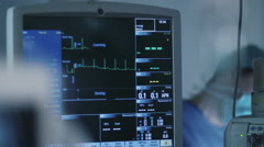 Shot of ECG Monitor in Operating Room During Surgical Operation Stock Footage