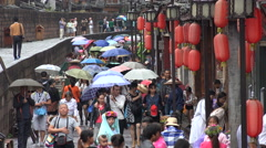 China domestic tourism, crowds walk in renovated shopping street Fenghuang - stock footage