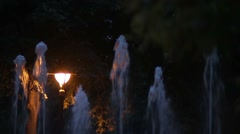Artesian fountain with several threads of water that goes during the night - stock footage