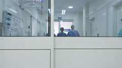 Team of Doctors and Nurses Walking through Hospital Stock Footage