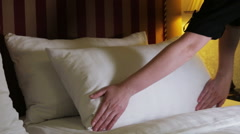 woman keeps  the linen on the bed - stock footage