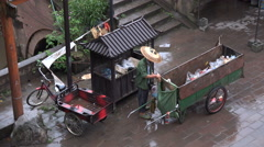 China poverty, inequality, municipal worker removing plastic from bins - stock footage