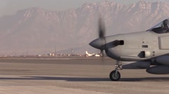 Stock Video Footage of AFGHANISTAN, JANUARY 2016, A A-29 Super Tucano Aircraft Cross Airfield