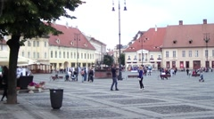 People which is a walk in the central square of a city paved with stone Stock Footage