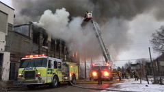 Dayton Ohio fire department putting out blaze at warehouse 4k Stock Footage