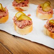 Fresh homemade fingerfood with pate and pickles - stock photo