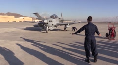 AFGHANISTAN, JANUARY 2016, Afghan Soldier Give Stop Signal A-29 Super Tucano Stock Footage
