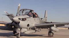 AFGHANISTAN, JANUARY 2016, Pilots A-29 Super Tucano Aircraft Exit Cockpit Stock Footage
