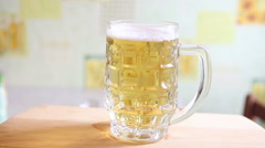 mug with beer taken from the table, close-up - stock footage