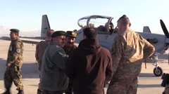 AFGHANISTAN, JANUARY 2016, Afghan Pilot Talks To Other Soldiers Background Stock Footage