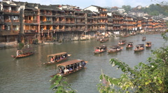 Wooden stilt houses in beautiful restored ancient Chinese village - stock footage