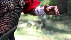 Roman soldiers struggling in the forest, one of them falls pierced by the sword Stock Footage