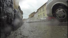 Speed car that runs on a sloping street in the middle of a medieval town Stock Footage