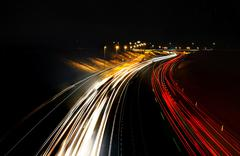 Busy night highway - stock photo