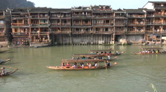 Traditional wooden houses are now hotels and guesthouses, Fenghuang, China Stock Footage