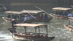 Groups of Chinese tourists sail through a stream in Fenghuang Stock Footage