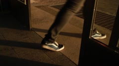 Feet close at dusk through sliding doors Stock Footage
