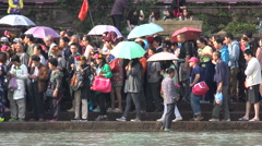 China inequality, poverty, local woman sells souvenirs to middle class visitors - stock footage