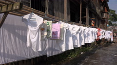 Clothing on washing line, traditional wooden house in Chinese village Stock Footage