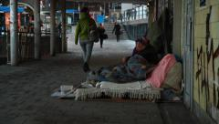 Homeless migrant begging at Slussen in central Stockholm Stock Footage
