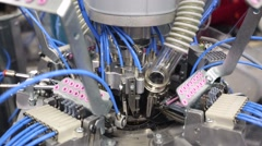 View of three dimensional knitting machine in a factory of knitted underwear. - stock footage