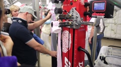 Worker measures new pantyhose on a special machine - stock footage
